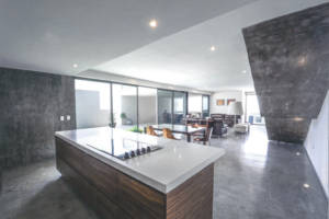 iTe CEMOX decorative screed finish applied to the dining and kitchen area of a contemporary home